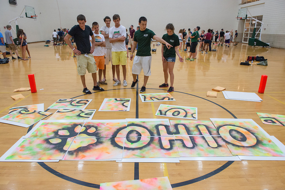 Students put together large puzzle pieces to create a message for new freshman at the Ping Center during Bobcat Student Orientation 2013. July 18, 2013. Photo by Elizabeth Held