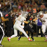 08 October 2016: The San Diego State Aztecs football team open's up the mountain west conference season at home against the University of Nevada Las Vegas Rebels. San Diego State line backer Austin Wyatt-Thayer (43) sacks UNLV quarterback Dalton Sneed (18) in the third quarterThe Aztecs beat the Rebels 26-7 to improve to 4-1 and 1-0 in conference play. www.sdsuaztecphotos.com