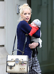 Peaches Geldof, fiancé Thomas Cohen and son Astala visit The Portland Hospital for Women and Children outpatients in Great Porland Street. As the pair arrived at the hospital, Peaches was kissing and holding Astala, as for Thomas he looked to have his hands full with a shoulder bag, Peaches handbag, bottle of milk, baby carrier and holding onto their beloved dog Parpy. Peaches wearing a blue cardigan, black top and a long checked skirt left the hospital about half an hour later and got a taxi to Berkeley Square for their dog Parpy to have a quick run around, before heading home. London, UK. 03/07/2012 <br />