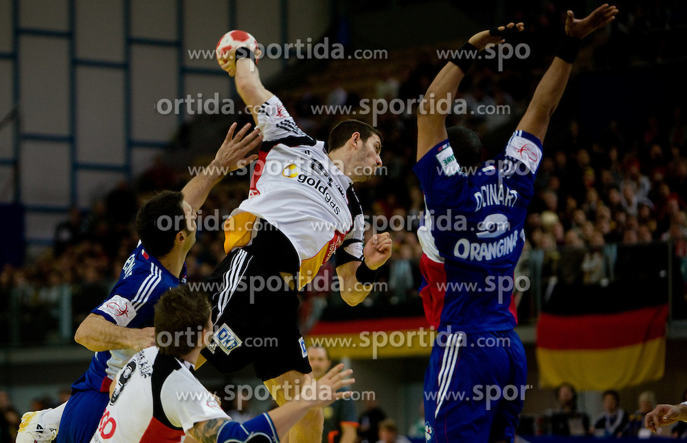 Michael Haass of Germany vs Didier Dinart of France during the Men's Handball European Championship Main Round match between Germany and France at the Olympia Hall on January 24, 2009 in Innsbruck, Austria. (Photo by Vid Ponikvar / Sportida) - on January 2010