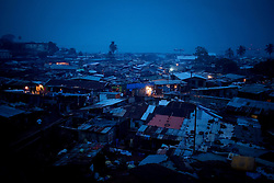 Night falls over Kroo Bay in Freetown, Sierra Leone.