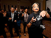 "Ohio University President Roderick J. McDavis, third from left, participates in ""line dancing"" at the All Black Affair at Baker University Center Ballroom at Ohio University on Friday, January 29, 2016. © Ohio University / Photo by Sonja Y. Foster"