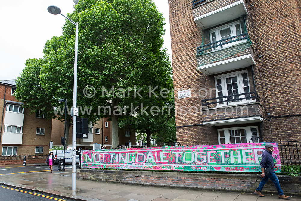 London, UK. 13 June, 2019. A banner close to the Grenfell Tower in North Kensington. Tomorrow, the Grenfell community will mark the second anniversary of the Grenfell Tower fire on 14th June 2017 in which 72 people died and over 70 were injured. Two years on, some family members remain in temporary accommodation and many are still traumatised. Phase 2 of the Grenfell Inquiry will begin in 2020, with criminal investigation findings expected to be sent to the Crown Prosecution Service in 2021.