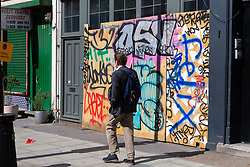 Shops and properties in the west London area of the Notting Hill Carnival prepare for the hundreds of thousands of revellers by erecting protective hoardings. London, August 24 2018.