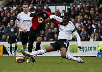 Photo: Steve Bond/Sportsbeat Images.<br /> Derby County v Blackburn Rovers. The FA Barclays Premiership. 30/12/2007. Benni McCarthy (C) is tackled by Claude Davis (R)