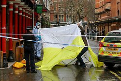 © Licensed to London News Pictures. 03/03/2019. London, UK. Police tent been building at the crime scene outside The Coach and Horses pub in Romilly Street in Soho. According to the police, a man aged 30 yrs old is seriously injured in hospital and a woman has been arrested. Photo credit: Dinendra Haria/LNP