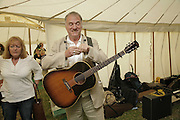 Ralph McTell, The Cornish Birthday party to Celebrate John Betjeman's Centenary. Carruan Farm. Polzeath. Conrwall. In aid of the new Padstow Lifeboat Station. 28 August 2006. ONE TIME USE ONLY - DO NOT ARCHIVE  © Copyright Photograph by Dafydd Jones 66 Stockwell Park Rd. London SW9 0DA Tel 020 7733 0108 www.dafjones.com