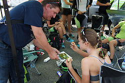 Kristabel Doebel-Hickok signs an autograph at Grand Prix de Plouay Lorient Agglomération a 121.5 km road race in Plouay, France on August 26, 2017. (Photo by Sean Robinson/Velofocus)