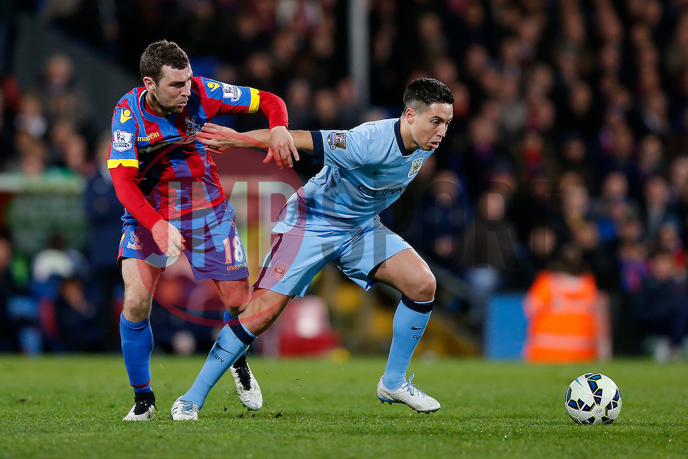 Samir Nasri of Manchester City is challenged by James McArthur of Crystal Palace - Photo mandatory by-line: Rogan Thomson/JMP - 07966 386802 - 06/04/2015 - SPORT - FOOTBALL - London, England - Selhurst Park - Crystal Palace v Manchester City - Barclays Premier League.