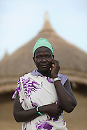 Adhuom Achiek Buol, 32, Manydeng Village, Jonglei State, South Sudan. Farmer<br /> <br /> &quot;Farming will stop hunger. We the people of Jonglei were created to farm. It is in our culture. It is what we were born to do.&quot;<br /> <br /> The Catholic Relief Services (CRS) led Jonglei Food Security Program, JFSP, in Jonglei, South Sudan aims to address the root causes of hunger in Jonglei State while teaching people new skills that will help them fight hunger and provide for themselves. Roads, dykes, and water retention ponds have been built by JFSP participants, assets that will help the communities access market, mitigate flood risks, and provide watering holes for livestock during the dry season. Generously funded by the American people through USAID, the JFSP is a three-year program that will run through 2014.