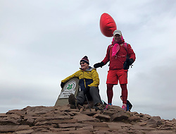 Father-of-three Des Lally with his father, Des Lally Snr as he reaches the peak of Pen y Fan - the highest peak in south Wales - for the 365th time in a year.
