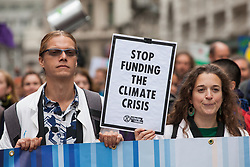 London, UK. 14 October, 2019. Climate activists from Scientists for Extinction Rebellion, including Dr Emily Grossman (r), march close to London Bridge in the City on the eighth day of International Rebellion protests across London. Today's activities were concentrated around the City of London's finance district.