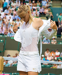 LONDON, ENGLAND - Tuesday, June 24, 2008: Maria Sharapova (RUS) takes off her tailored jacket before her first round match on day two of the Wimbledon Lawn Tennis Championships at the All England Lawn Tennis and Croquet Club. (Photo by David Rawcliffe/Propaganda)
