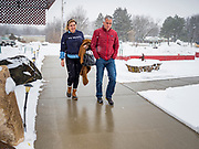 """24 JANUARY 2020 - POLK CITY, IOWA: LUCY CALDWELL and JOE WALSH walk through a snowstorm into a campaign event in Polk City, northwest of Des Moines, Caldwell is Walsh's campaign manager. Walsh, a conservative radio personality, former Republican congressman, and one time supporter of Donald Trump is now challenging Trump for the Republican nomination for the US Presidency. During his appearance in Polk City, Walsh said Trump is unfit to be the President because he is a """"cheater,"""" a climate change denier, and a """"threat"""" to the United States.       PHOTO BY JACK KURTZ"""