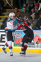 KELOWNA, CANADA - MARCH 1: Rodney Southam #17 of the Kelowna Rockets collides with Jared Bethune #21 of the Prince George Cougars on MARCH 1, 2017 at Prospera Place in Kelowna, British Columbia, Canada.  (Photo by Marissa Baecker/Shoot the Breeze)  *** Local Caption ***