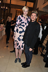 GWENDOLINE CHRISTIE and HENRY HOLLAND at a dinner hosted by Pablo Ganguli and Ella Krasner to celebrate the 10th Anniversary of Liberatum and in honour of Sir Peter Blake held at The Corinthia Hotel, Nortumberland Avenue, London on 23rd November 2011.