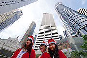 Singapore. Raffles Place. Santa Clauses and skyscrapers.