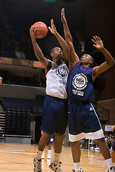 PF Richard Howell (Marietta, GA / Wheeler) gets a shot off over PF Wally Judge (Jacksonville, FL / Arlington Country Day).  The NBA Player's Association held their annual Top 100 basketball camp at the John Paul Jones Arena on the Grounds of the University of Virginia in Charlottesville, VA on June 20, 2008