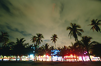 USA, Florida, Miami Beach, Art Deco District buildings illuminated at