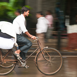A cyclist races through the streets of Mumbai.