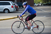 Anne Dawson bikes during the O'Bleness Race for a Reason Triathlon Saturday, April 27, 2013. The triathlon included a 500mm Serpentine Swim at the Ohio University Aquatic Center, a 15 mile bike ride to the Plains and back and then a 5k run that finished at Tailgreat Park across from Peden Stadium. . Race for a Reason, Race 4 A Reason, Annual Events, Events, Students, Faculty & Staff
