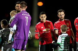 Manchester United's Alexis Sanchez (centre) shakes Yeovil Town players and mascots hands before the Emirates FA Cup, fourth round match at Huish Park, Yeovil.