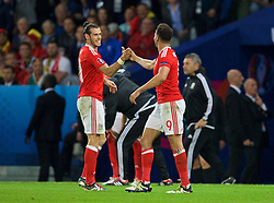 LILLE, FRANCE - Friday, July 1, 2016: Wales' Hal Robson-Kanu celebrates scoring the second goal against Belgium with team-mate Gareth Bale during the UEFA Euro 2016 Championship Quarter-Final match at the Stade Pierre Mauroy. (Pic by David Rawcliffe/Propaganda)