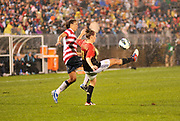 "U.S. Women's National Team midfielder Shannon Boxx fights for the ball against Germany's striker Anja Mittag during the ""Fan Tribute Tour"" game held at the Rentschler Field in East Hartford, Connecticut on Tuesday, October 23, 2012. The U.S. tied Germany 2-2."