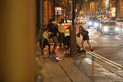 Manchester UK 18.12.2016: Pictures from a Street Brawl at  430am this morning saw that man who started the fight, stabbed with a  broken bottle by a male who stabbed him 3 times and then stamped on him. <br /> <br /> This took place on Princess Street in Manchester witch is a very  busy road.<br /> <br /> A video is available of this incident