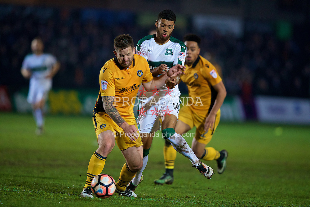 NEWPORT, WALES - Wednesday, December 21, 2016: Newport County's Darren Jones in action against Plymouth Argyle's Jake Jervis during the FA Cup 2nd Round Replay match at Rodney Parade. (Pic by David Rawcliffe/Propaganda)