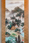 """Shan Shui with The Four Symbols"" Japanese landscape hand-painting of Gassho-zukuri farmhouses with river, waterfall and forest, by Tomohisa Miyazaki (born in Gifu in 1955), on Washi Japanese paper, mounted on silk & polyester. Kyoto Museum of Traditional Crafts (or Fureaikan), in the Miyako Messe building, Sakyo Ward, Kyoto, Japan."