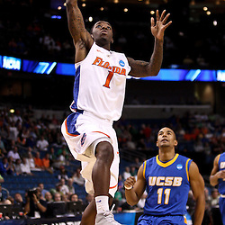 Mar 17, 2011; Tampa, FL, USA; Florida Gators guard Kenny Boynton (1) dunks over UC Santa Barbara Gauchos guard Justin Joyner (11) during first half of the second round of the 2011 NCAA men's basketball tournament at the St. Pete Times Forum.  Mandatory Credit: Derick E. Hingle