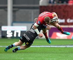 Scarlets' Hadleigh Parkes is tackled by Glasgow Warriors' Nick Grigg<br /> <br /> Photographer Simon King/Replay Images<br /> <br /> Guinness PRO14 Round 19 - Scarlets v Glasgow Warriors - Saturday 7th April 2018 - Parc Y Scarlets - Llanelli<br /> <br /> World Copyright © Replay Images . All rights reserved. info@replayimages.co.uk - http://replayimages.co.uk