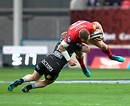 Scarlets' Hadleigh Parkes is tackled by Glasgow Warriors' Nick Grigg<br /> <br /> Photographer Simon King/Replay Images<br /> <br /> Guinness PRO14 Round 19 - Scarlets v Glasgow Warriors - Saturday 7th April 2018 - Parc Y Scarlets - Llanelli<br /> <br /> World Copyright &copy; Replay Images . All rights reserved. info@replayimages.co.uk - http://replayimages.co.uk