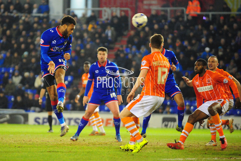Aaron Holloway of Oldham Athletic (On loan from Wycombe Wanderers) heads at goal during the Sky Bet League 1 match between Oldham Athletic and Blackpool at SportsDirect.Com Park, Oldham, England on 15 March 2016. Photo by Mike Sheridan.