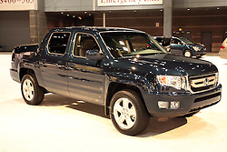 11 February 2009: Honda Ridgeline 4DR RTL NAV. 2009 HONDA RIDGELINE: Updated for ?09, the Honda Ridgeline boasts a total of 50 significant changes and new features, including revisions to the grille, bumpers, and headlight and taillight color combinations. Inside, styling updates include revised three-dimensional-style meters, a new steering wheel design, and enhanced controls, buttons and displays. All ?09 four-door, five-passenger Ridgelines are powered by a 250-horsepower, 3.5-liter VTEC V-6 engine. A 5-speed electronically-controlled automatic transmission and a Variable Torque Management 4-wheel drive system are standard. Upgrades have also been made to the starter motor, now more powerful and quick-starting. A maximum recommended tow capacity is 5,000 pounds. The 5-foot-long composite cargo bed provides a half-ton payload rating of 1,100 lbs..The Chicago Auto Show is a charity event of the Chicago Automobile Trade Association (CATA) and is held annually at McCormick Place in Chicago Illinois.