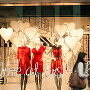 Pedestrian passing a shopfront display in Bourke Street Mall in Melbourne's city centre.