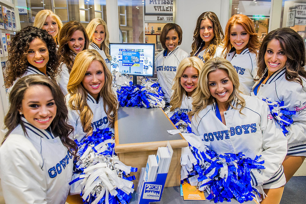 Dallas Cowboys Cheerleaders  in the information booth at  Marylebone Station - Chiltern Railways commuters are greeted by a 'bevy of American beauties' on the Main Concourse. Chiltern Railways runs fast services to Wembley Stadium where American football teams the Jackson Jaguars take on the Dallas Cowboys on Sunday 9 November.