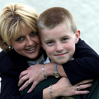 10 year old Roghainn Patterson with his mother Hazel after being presented with a Tayside Police Meritorious Conduct Certificate by Chief Constable William Spence. Roghainn received the award for helping his mothers partner who he found collapsed on the floor at home.<br />