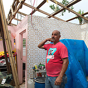 Salinas, PR November 9, 2017--Juan Jose Gonzalez ColÛn walks through his home destroyed during Hurricane Maria on September 20, 2017. Even through he has decided to start to repair the roof of his home in Salinas, PR, he has left all his furniture, clothes and belongings in place so if FEMA comes to investigate his application for support, he can show the evidence that he has lost everything. Photo by Lori Waselchuk/braf.org