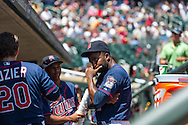 Minnesota Twins center fielder Denard Span jokes around with his teammates in the dugout before a game against the Cleveland Indians at Target Field in Minneapolis, Minnesota on July 29, 2012.  The Twins defeated the Indians 5 to 1.  © 2012 Ben Krause