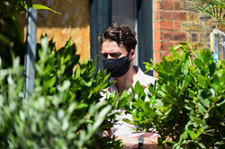 © Licensed to London News Pictures. 05/07/2020. LONDON, UK.  A plant lover visits Columbia Road Flower Market in East London on the its reopening after certain coronavirus pandemic lockdown restrictions were relaxed by the UK government.  Photo credit: Stephen Chung/LNP