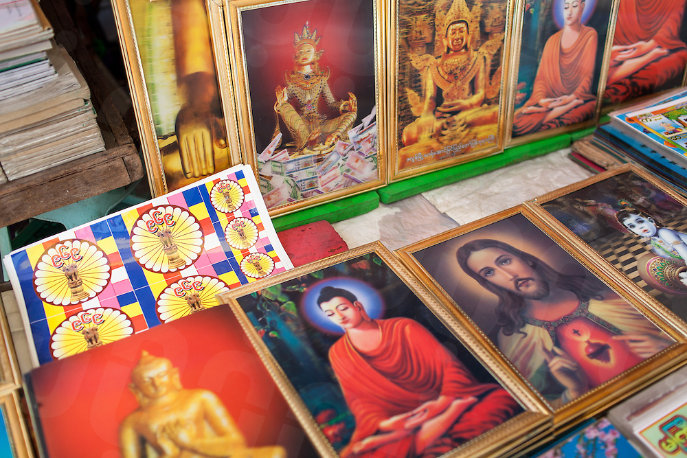 A street shop in Downtown Yangon sells the 969 stickers. They are sold and distributed through out Myanmar to label shops and business as being Buddhist own and run. 16 June 2013 © Nicolas Axelrod  / Ruom