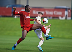 KIRKBY, ENGLAND - Saturday, August 31, 2019: Liverpool's Billy Koumetio (L) and Manchester United's Charlie Wellens during the Under-18 FA Premier League match between Liverpool FC and Manchester United at the Liverpool Academy. (Pic by David Rawcliffe/Propaganda)