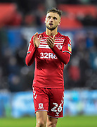 Lewis Wing (26) of Middlesbrough applauds the travelling fans at full time during the EFL Sky Bet Championship match between Swansea City and Middlesbrough at the Liberty Stadium, Swansea, Wales on 14 December 2019.