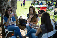 Young girls from the Iraqi Chaldeans community gather in a park to picnic and socialize on Saint George's day. More than 11,000 Iraqi refugees have arrived in the El Cajon area in the past few years. The culture and traditions of the Iraqi community are beginning to transform the working-class town located East of San Diego, just north of the Mexican border. El Cajon, CA. USA. 28/04/2013.