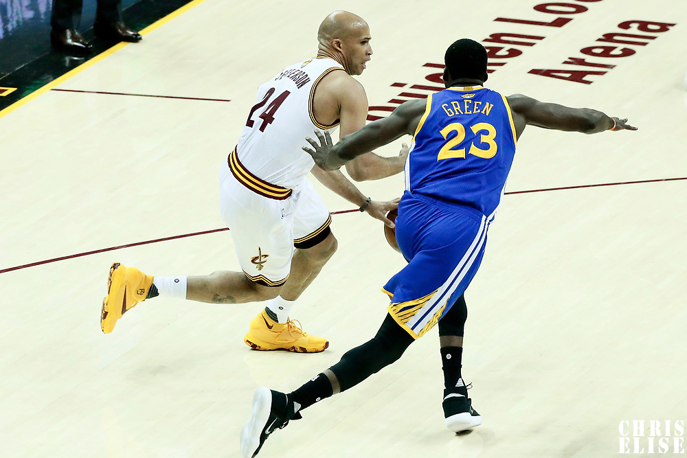 07 June 2017: Cleveland Cavaliers forward Richard Jefferson (24) drives past Golden State Warriors forward Draymond Green (23) during the Golden State Warriors 118-113 victory over the Cleveland Cavaliers, in game 3 of the 2017 NBA Finals, at  the Quicken Loans Arena, Cleveland, Ohio, USA.