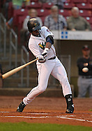 Kernels right fielder Adam Brett Walker II (38) swings at a pitch during a game between the Cedar Rapids Kernels and the Quad Cities River Bandits at Veterans Memorial Stadium in Cedar Rapids, Iowa on June 5, 2013.