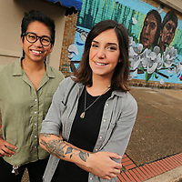 Tupelo artist M.J. Torrecampo, left, and Lujan Perez spent weeks painting a mural on Broadway Street in Tupelo.