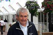 France, Cannes, film director Claude Lelouch looking at the camera on his way to the entrance of the Palace de Cinema, Cannes Film Festival 2013